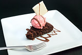 Brownie With Raspberry Icecream, Fork On Plate