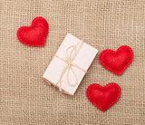 Three hearts and pink gift box