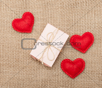 Three hearts and pink gift box