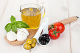 Mozzarella, olives, tomatoes and basil