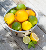 Fresh ripe citruses in colander