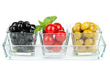 Black and green olives and tomatoes with basil