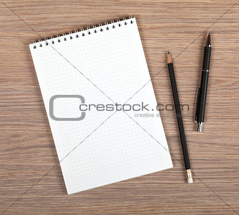 Blank notepad with pen and pencil