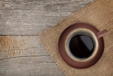 Coffee cup on wooden table texture