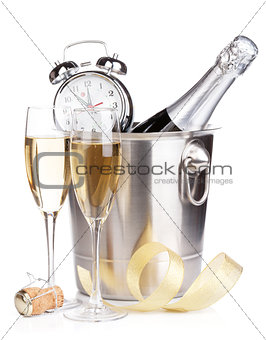 Christmas champagne with alarm clock in bucket