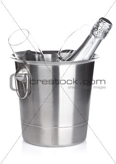 Champagne bottle in bucket and empty glasses