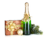Champagne bottle, christmas gift box, decor and fir tree