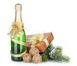 Champagne bottle, christmas gift and snowy firtree