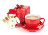 Red coffee cup, gift box and snowman toy