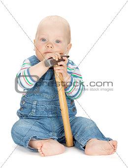 Small cute baby boy worker in jeans