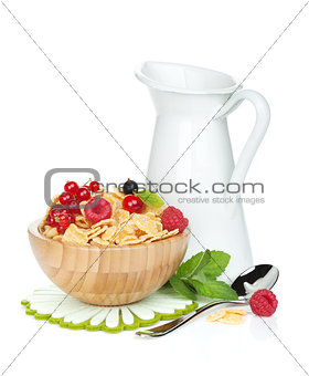 Fresh corn flakes with berries and milk jug