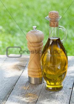 Olive oil bottle and pepper shaker