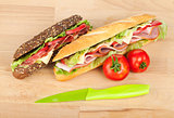 Fresh sandwiches with meat and vegetables and tomatoes