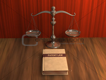 Scale and patent law book on the table