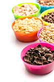 various sweet cereals in colorful bowls