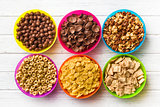 various kids cereals in colorful bowls