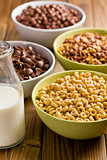 various sweet cereals in bowls