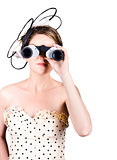 Retro woman looking through binoculars