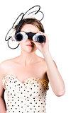 Retro woman looking through binoculars