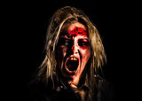 Evil zombie girl screaming out in bloody horror