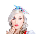 Retro style portrait of a blond girl with a bow