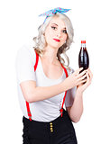 Retro blond woman with a bottle of soda