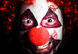 scary and evil clown smiling in dark spooky style