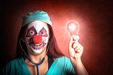 Clown doctor holding red emergency lightbulb