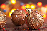 golden christmas ball over blurred colorful background