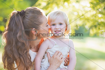 Portrait of happy mother and baby outdoors