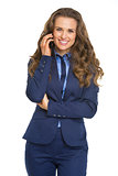 Smiling business woman talking mobile phone