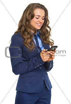 Happy business woman writing sms