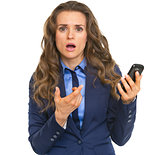 Frustrated business woman pointing on cell phone