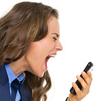 Angry business woman shouting in mobile phone