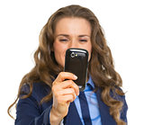 Closeup on business woman taking photo with cell phone