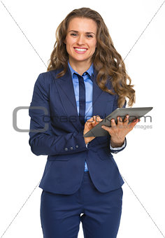 Happy business woman using tablet pc