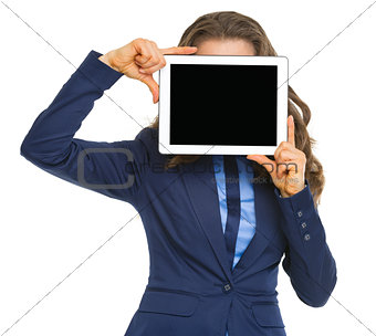 Business woman holding tablet pc with blank screen in front of f