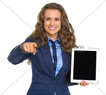 Business woman holding tablet pc with blank screen and pointing