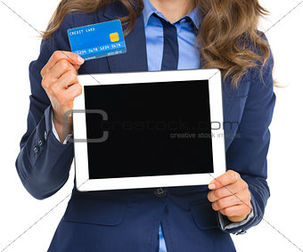 Closeup on business woman holding tablet pc blank screen and cre