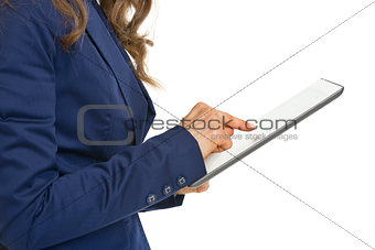 Closeup on business woman working on tablet pc
