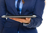 Closeup on business woman holding tablet pc