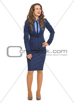 Full length portrait of smiling business woman looking on copy s