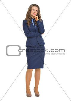 Full length portrait of thoughtful business woman