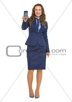 Full length portrait of smiling business woman showing cell phon
