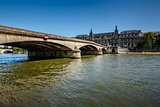 View of Louvre Palace and Pont du Carrousel in Paris, France