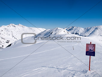 A sign in the Austrian alps wich says danger of avalanches