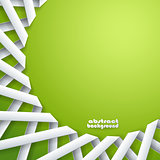 Abstract paper ribbons on green background