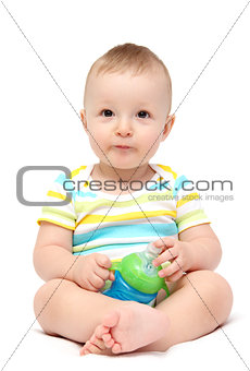 baby boy holding milk bottle