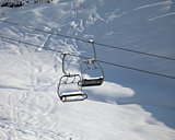 Two chair-lift with snowdrift in sun morning