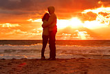 Couple Man and Woman Hugging in Love staying on Beach seaside with Sunset scenery People Romantic relationship and Friendship concept